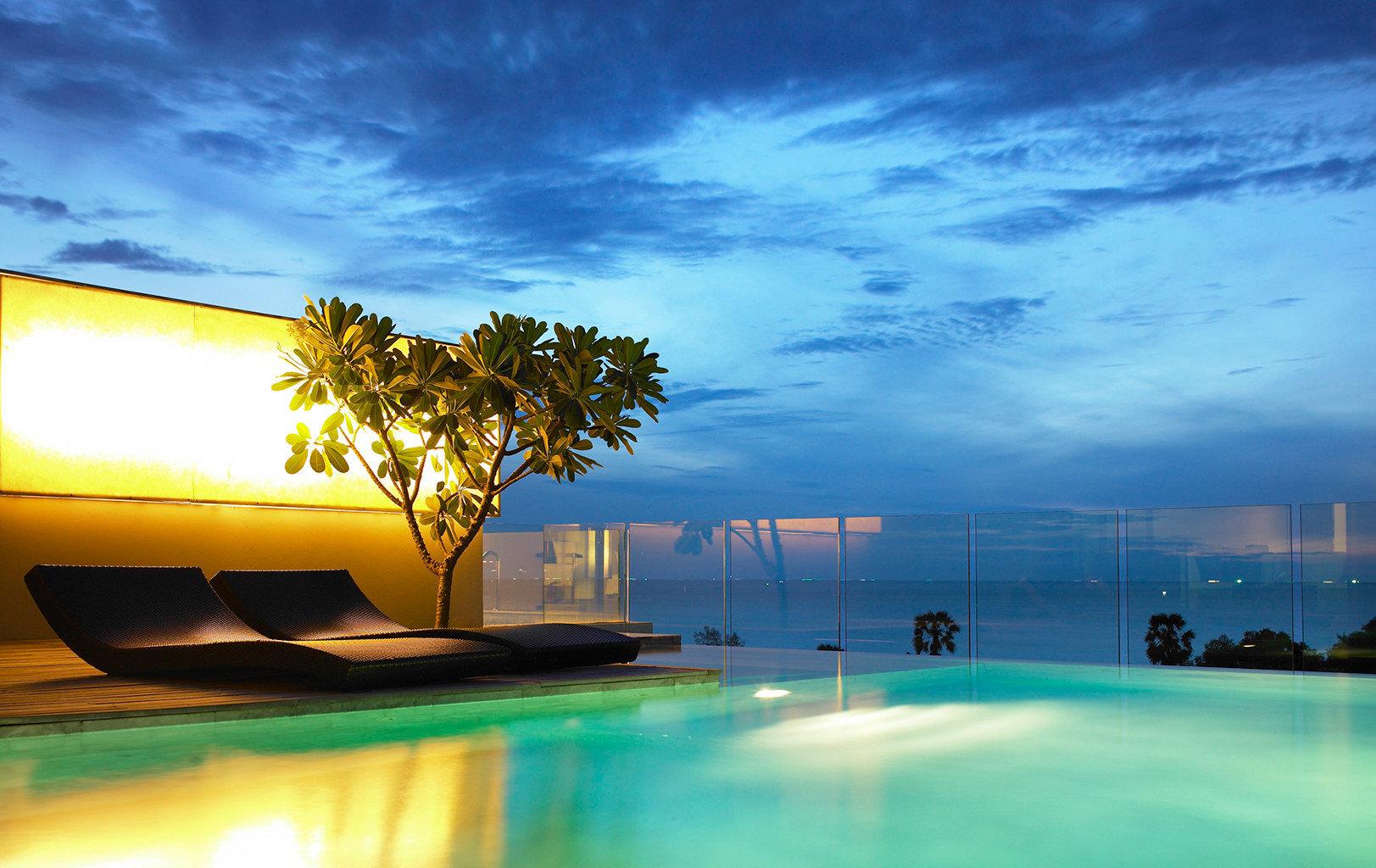 Beach Family Modern Resort sky swimming pool horizon Ocean light cloud Sea morning atmosphere of earth sunlight dusk evening Sunset sunrise shore