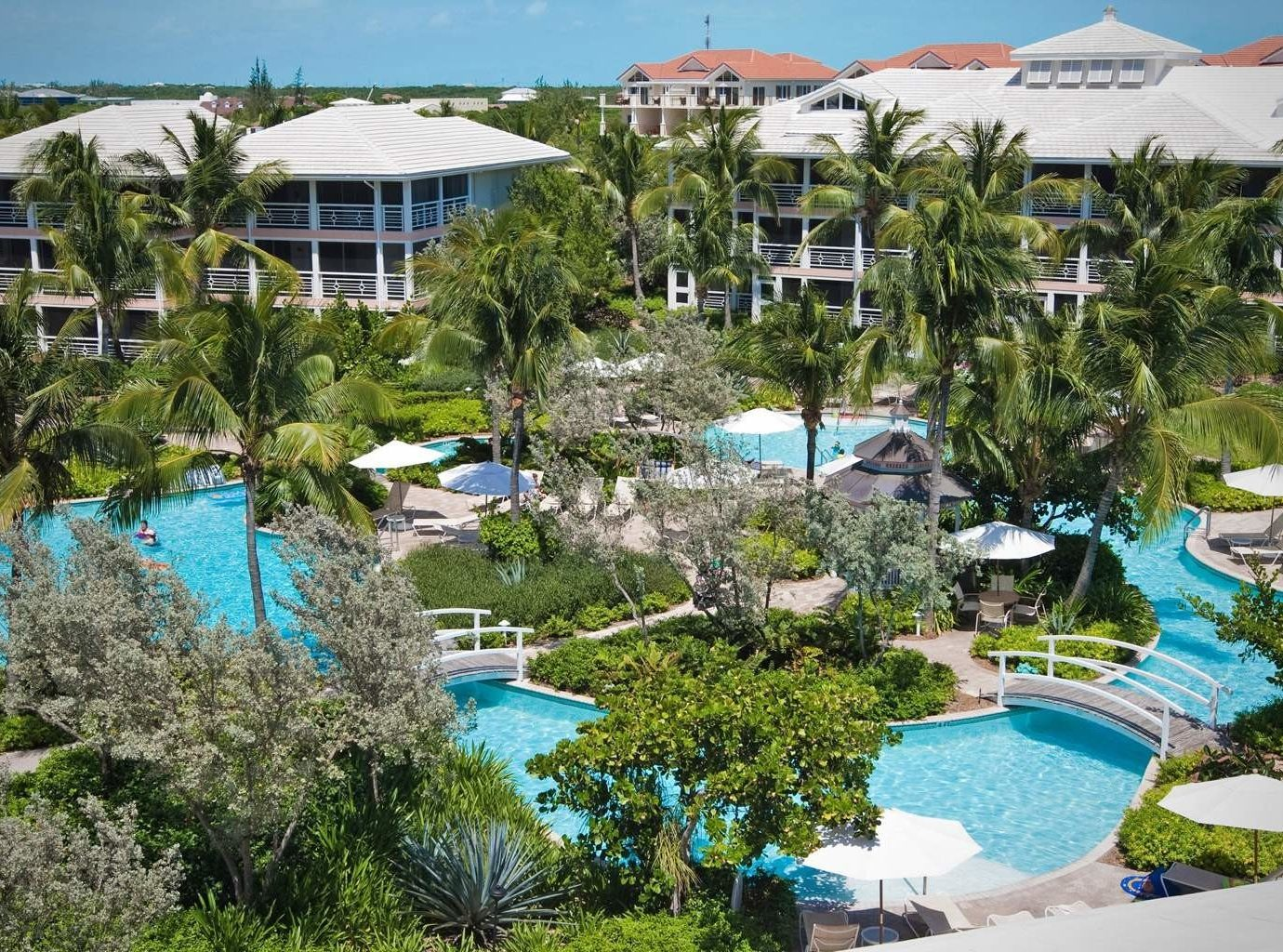 Grounds Hip Luxury Modern Pool building tree sky Resort grass leisure house property Water park Nature Beach marina caribbean swimming pool Village Garden