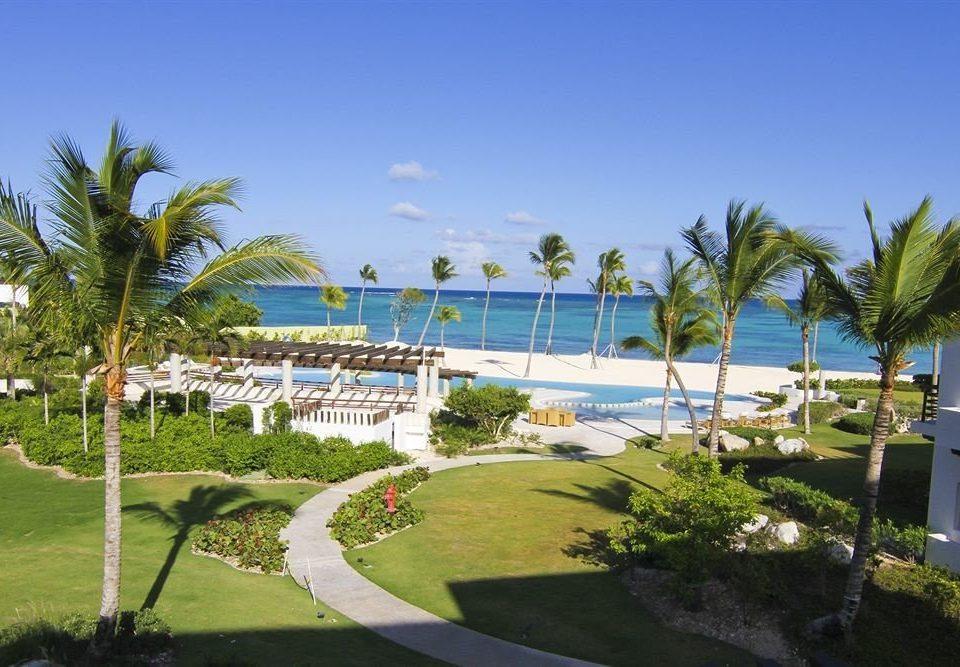 grass tree sky palm property Resort leisure plant swimming pool condominium Beach caribbean marina Garden Villa lawn arecales walkway mansion bushes