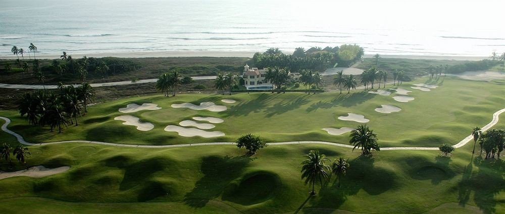 Beach Golf Honeymoon Resort Sport Waterfront grass structure plain ecosystem Nature grassland sport venue aerial photography golf course hill golf club paddy field field rural area landscape Terrace bird's eye view plateau meadow lawn agriculture race track plant shore highway