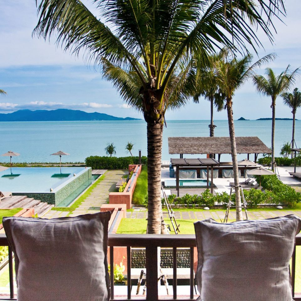 Grounds Lounge Pool Tropical sky tree palm leisure Beach chair property Resort caribbean plant arecales home condominium Villa lined shade