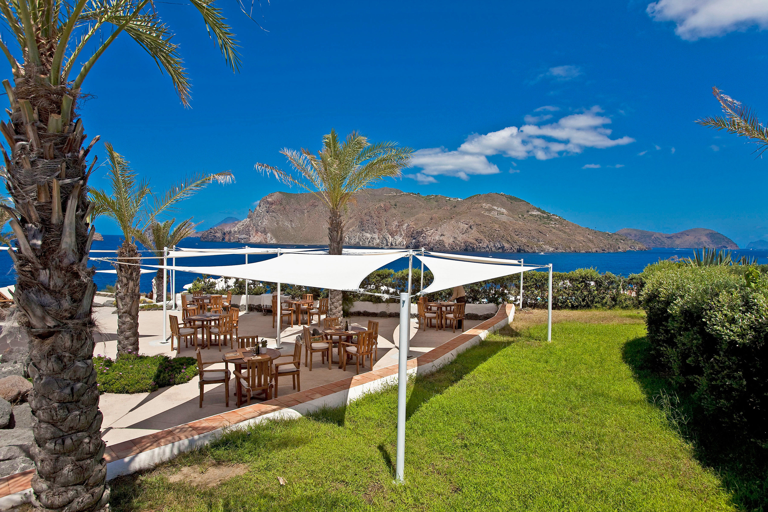 Beach Grounds Resort Romance Wellness grass tree sky property plant walkway Villa palm lush