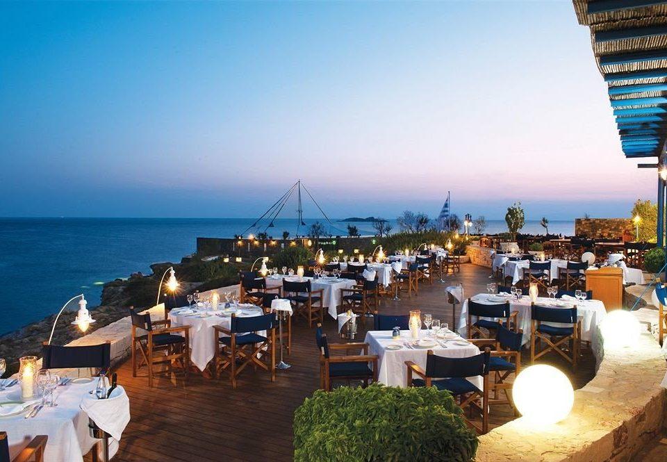 sky water chair Sea Resort Beach marina Ocean dock Harbor vehicle restaurant set overlooking day