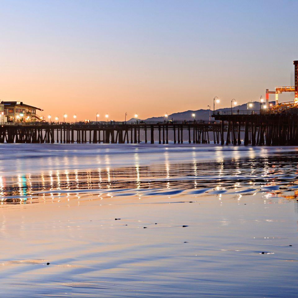 Beach Ocean Sunset water sky scene pier Sea night evening dusk vehicle Harbor cityscape wave