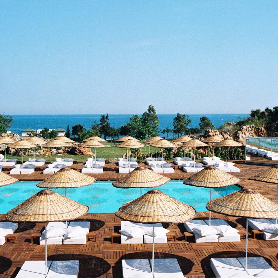 Hip Lounge Luxury Modern Pool sky umbrella chair leisure Beach Resort Sea swimming pool marina dock colorful set shore