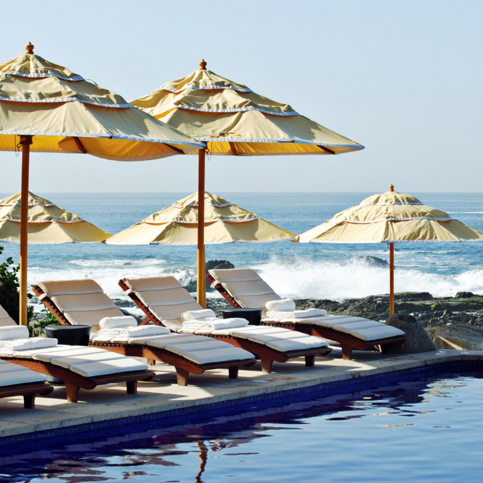 Honeymoon Luxury Pool Romance Romantic Scenic views Tropical Waterfront water sky leisure Resort Sea Beach swimming pool boating lined line day