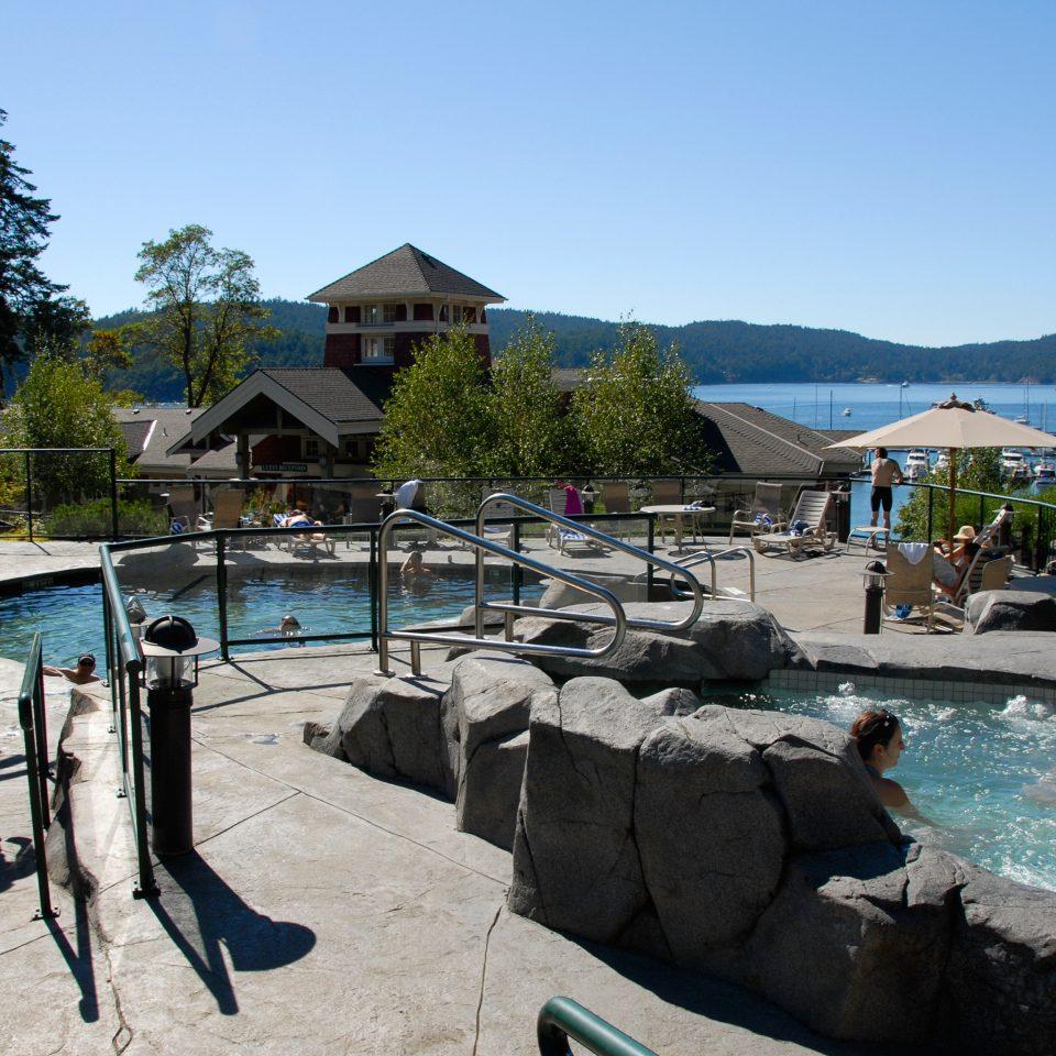 Hot tub Hot tub/Jacuzzi Play Pool Resort Scenic views Waterfront sky ground leisure swimming pool Beach Sea Water park Village
