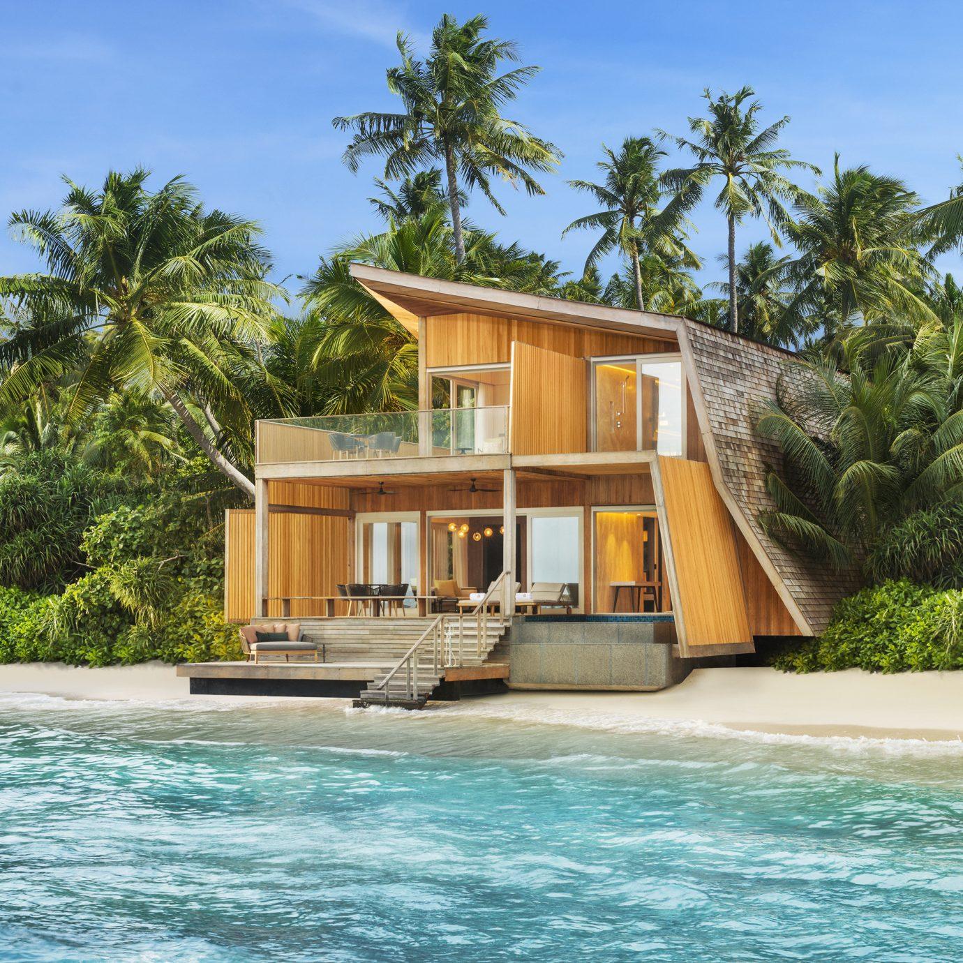 Hotels Offbeat tree water sky property house Resort caribbean swimming pool Villa home Lagoon Island Sea Beach tropics shore swimming