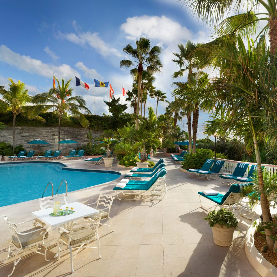 Hotels Lounge Luxury Pool tree sky leisure swimming pool property Resort Beach palm caribbean condominium lined Villa lawn Water park tropics arecales sandy shore day