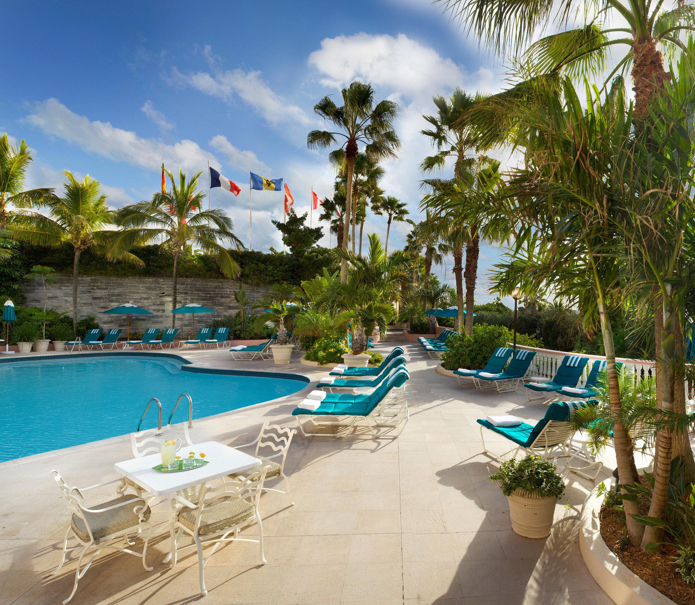 Hotels Lounge Luxury Pool tree sky leisure swimming pool property Resort Beach palm caribbean condominium lined Villa lawn Water park tropics arecales sandy shore day
