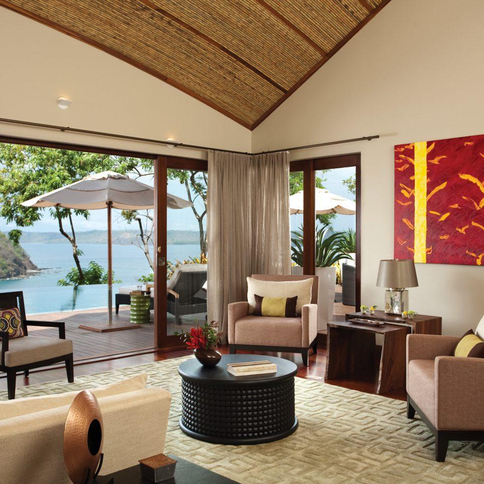 Beach Hotels Lounge Luxury Ocean Scenic views sofa property living room home Suite Villa condominium Resort
