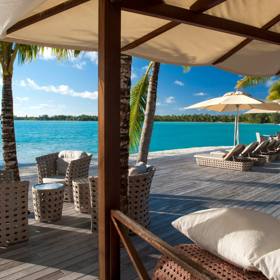 Beach Hotels Lounge Scenic views chair umbrella property leisure Resort caribbean swimming pool Villa cottage overlooking