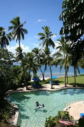 tree water palm Resort swimming pool caribbean arecales Lagoon lined Beach tropics Ocean reef Jungle plant shore Island