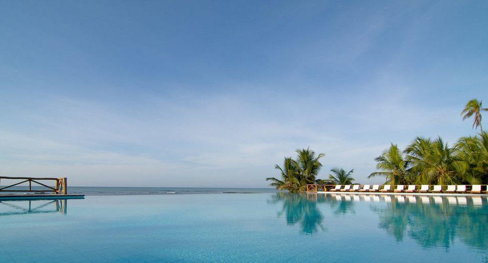water sky Sea swimming pool Lake Beach shore Ocean River Lagoon Resort Island caribbean day