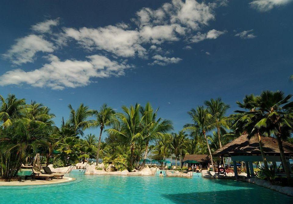 tree sky water caribbean Sea Beach Resort tropics arecales Ocean swimming pool Lagoon Island palm day