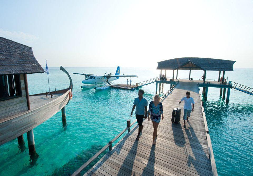 water sky leisure chair Sea caribbean Ocean pier Resort vehicle swimming pool Beach dock Lagoon Island shore swimming