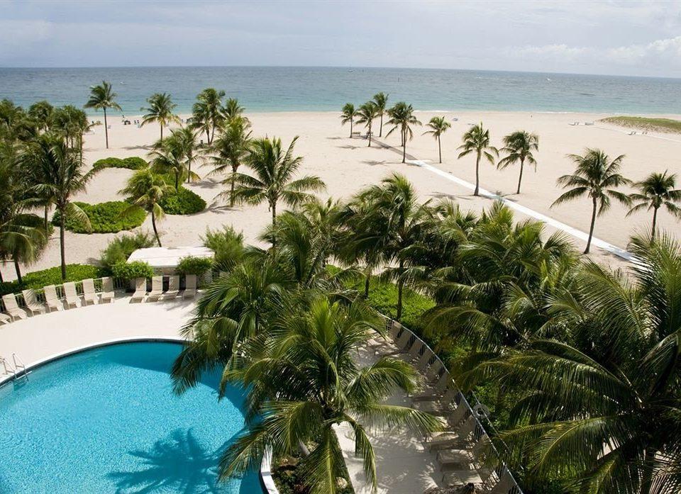 tree water caribbean property Resort plant tropics Beach arecales swimming pool Lagoon palm Sea palm family Island Pool shore