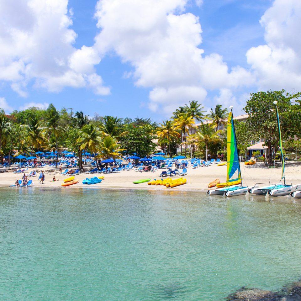 sky tree water leisure Sea Beach marina vehicle Lagoon Resort dock swimming pool tropics Island sand shore day swimming sandy