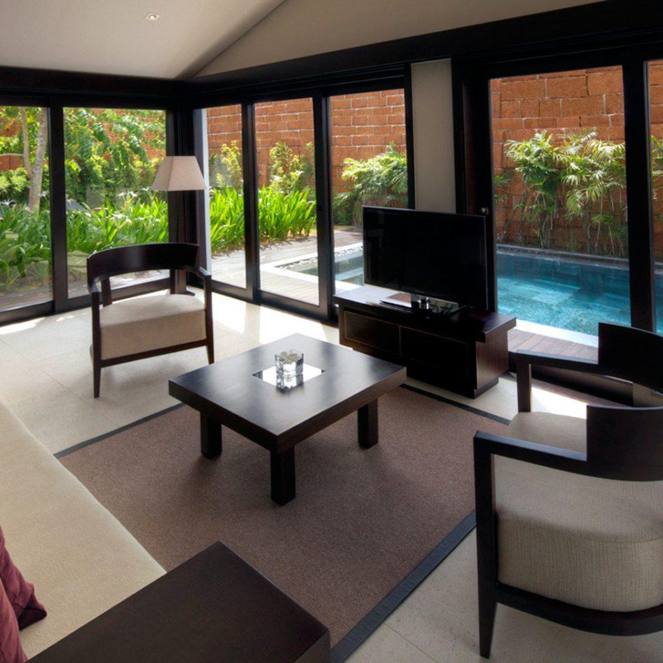 Beach Jungle Lounge Luxury Modern Ocean Patio Pool Resort Tropical Waterfront property living room condominium Villa Suite overlooking dining table