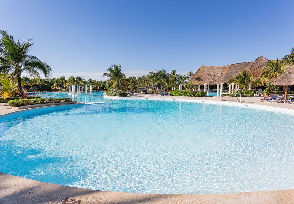 sky water Pool swimming pool Nature property Beach Resort leisure swimming caribbean Lagoon resort town Sea Villa Lake reef shore