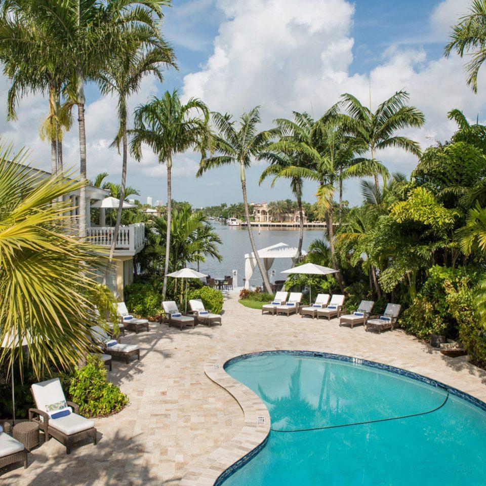Lounge Luxury Pool tree palm Beach ground swimming pool property Resort caribbean board arecales tropics palm family Villa Lagoon condominium plant swimming sandy