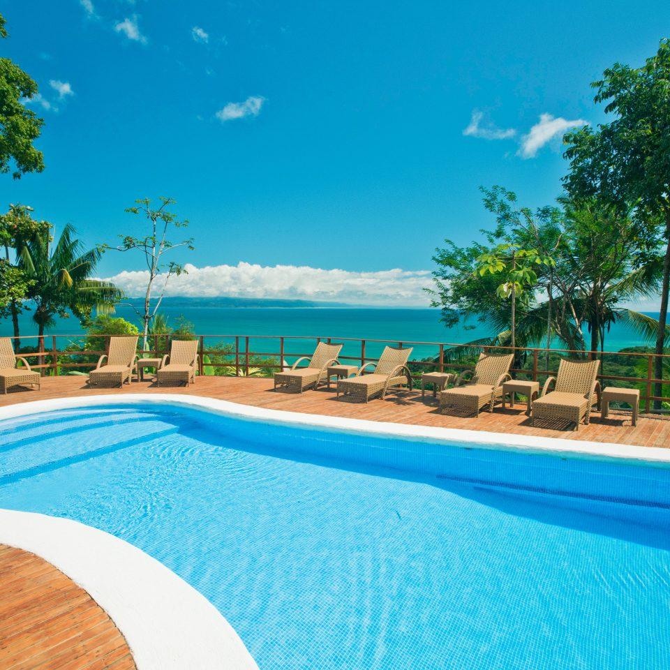 Lounge Luxury Modern Pool tree sky swimming pool leisure property Resort caribbean Nature swimming Villa resort town blue Lagoon Beach backyard reef shore