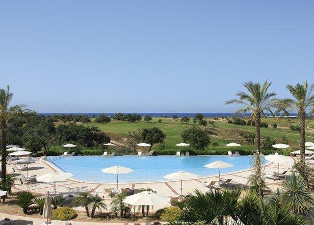 sky property swimming pool Resort Villa shore palm Nature marina home condominium Beach Lagoon lined sandy