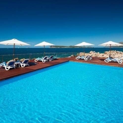 sky water umbrella Beach swimming pool property chair leisure Pool Resort marina caribbean Ocean blue Sea Lagoon resort town dock atoll swimming lined sandy
