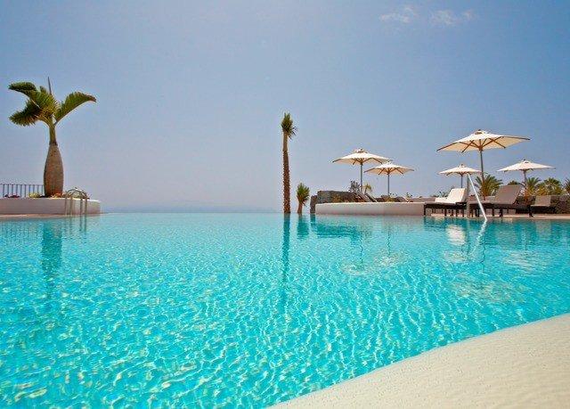 water umbrella sky chair swimming pool leisure property Resort blue caribbean Sea Pool swimming Ocean Beach Lagoon shore day