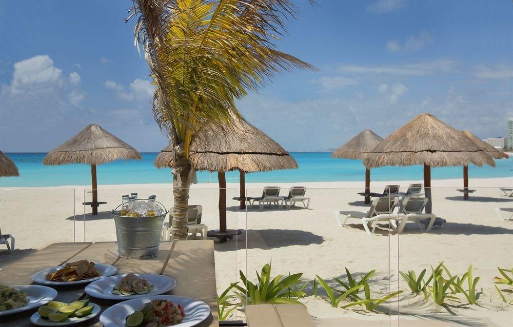 umbrella sky water chair Beach property caribbean Resort Sea Ocean Lagoon arecales lawn Villa set shore lined shade day