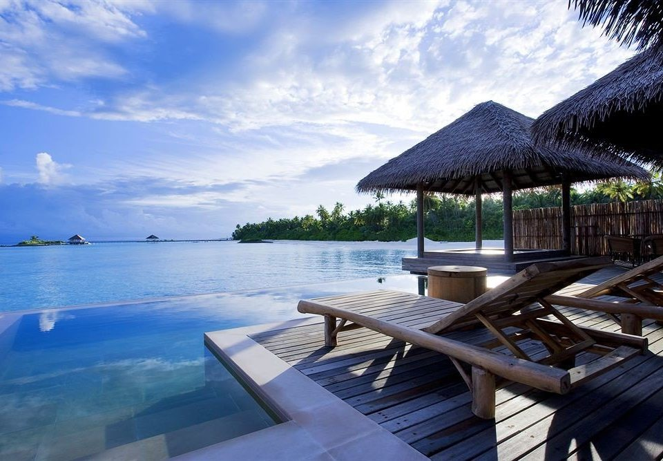 sky water leisure Resort Sea Ocean wooden caribbean Beach Lagoon swimming pool dock overlooking day shore shade