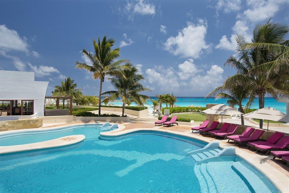 sky Resort tree swimming pool Pool property leisure Beach caribbean resort town Villa Water park Lagoon reef palm lined swimming