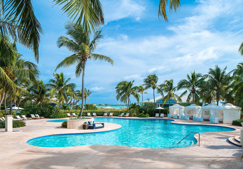 tree palm sky Pool Beach water Resort ground swimming pool swimming property leisure caribbean arecales lined Lagoon Villa Sea tropics condominium blue plant sunny sandy surrounded