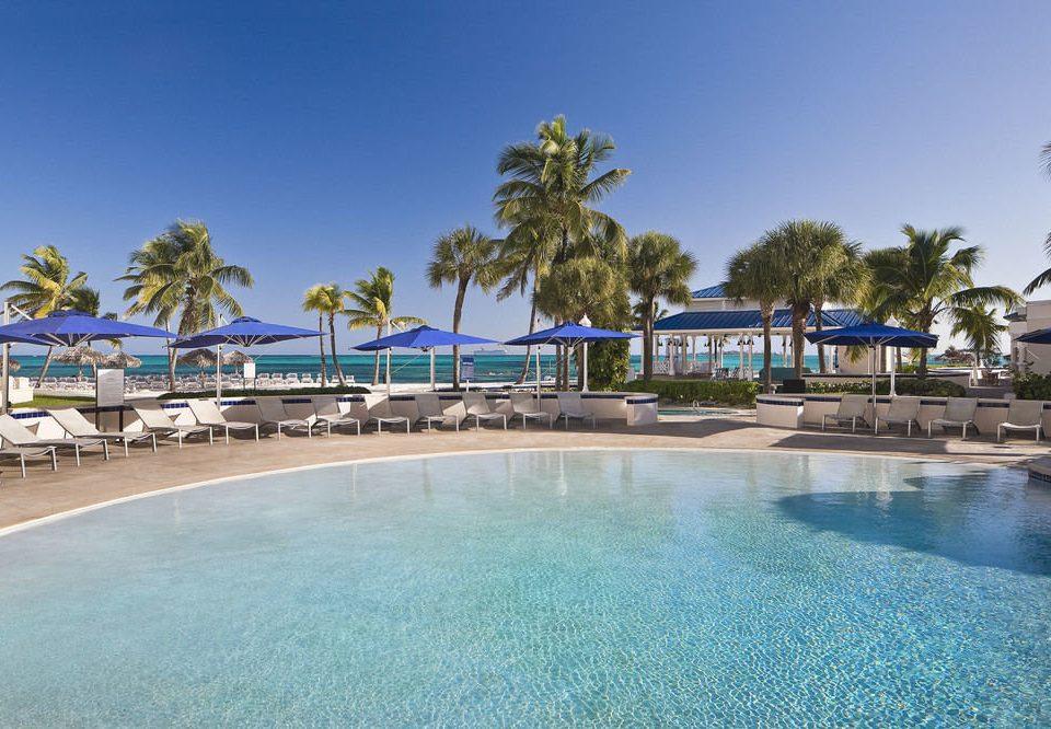 sky tree water swimming pool Resort property Pool Beach leisure marina caribbean resort town condominium Lagoon Sea palm dock shore swimming