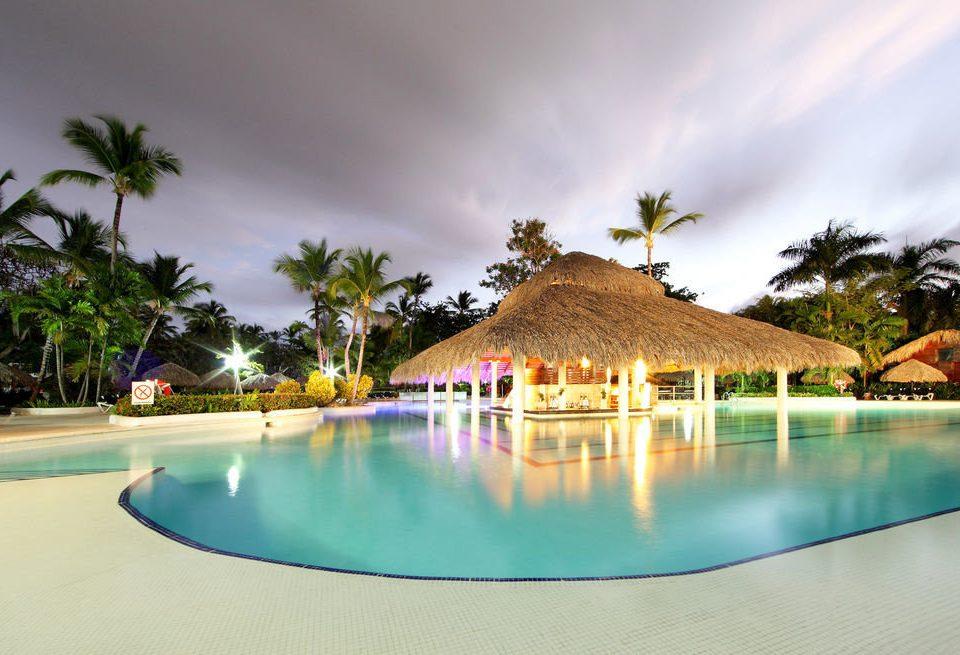 sky Pool swimming pool leisure Resort house caribbean arecales Beach Lagoon Villa tropics Sea palm swimming shore lined