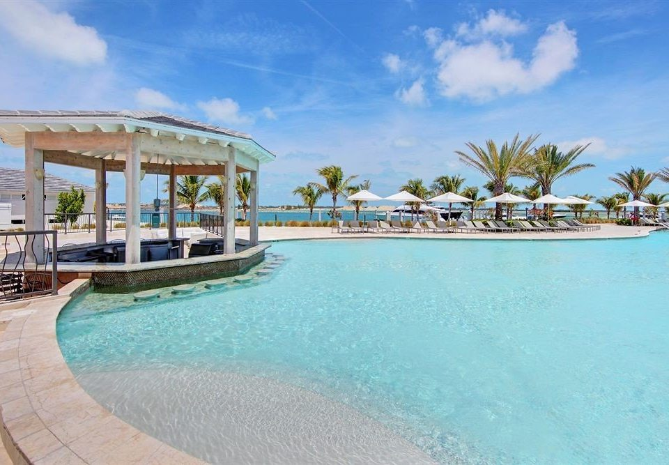 sky water Pool swimming pool property Resort leisure building caribbean Beach resort town Lagoon Villa Sea swimming shore