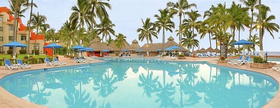tree Resort sky palm swimming pool property leisure Beach Pool caribbean water sport Water park resort town Lagoon lined swimming