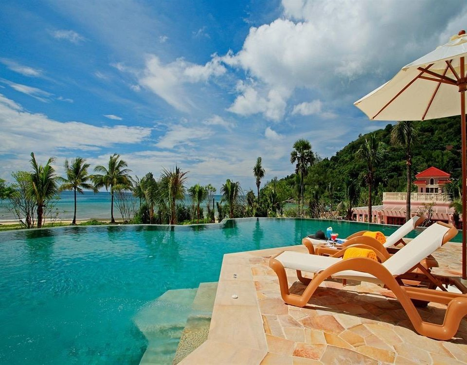 sky umbrella water chair Beach leisure swimming pool Resort lawn caribbean Sea Pool Lagoon Villa swimming shore day sandy