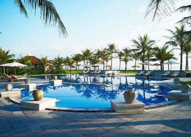 tree sky water Resort palm swimming pool Pool leisure property Beach blue caribbean marina resort town Lagoon Villa lined plant swimming shore sandy