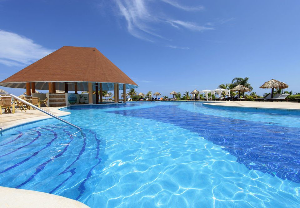 water sky Pool swimming pool swimming property Resort leisure blue Beach caribbean Lagoon resort town Villa Sea