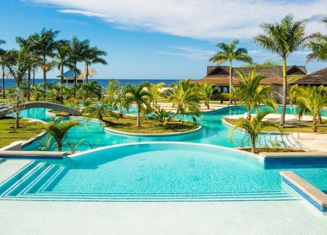 sky Beach swimming pool Resort property leisure Pool caribbean blue palm Villa condominium resort town Lagoon Water park lined swimming sandy shore