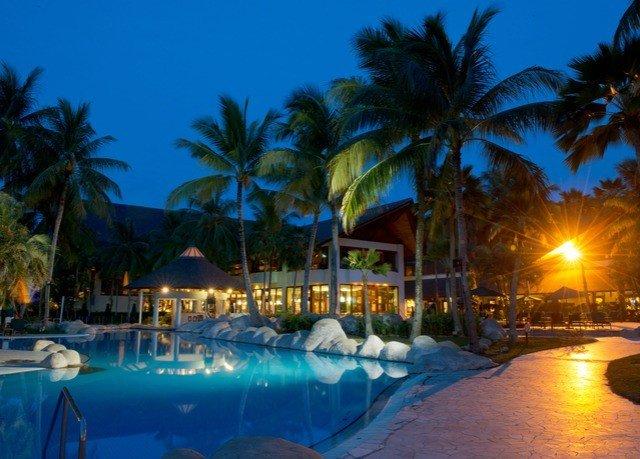 tree sky Resort palm swimming pool caribbean resort town arecales Lagoon Beach blue plant lined