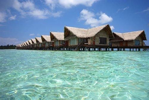 sky water property swimming pool Resort house caribbean Lagoon resort town Beach Sea swimming shore