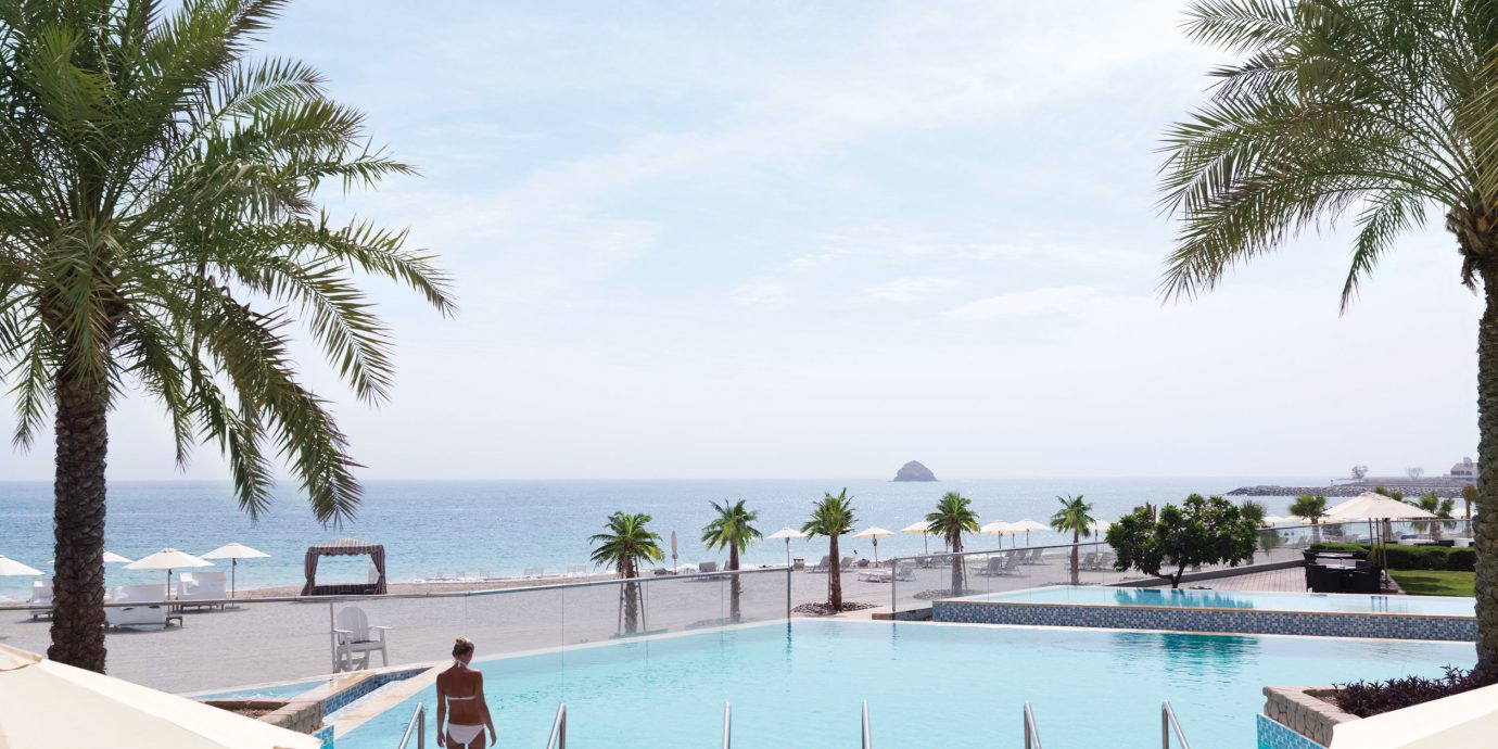 sky tree water swimming pool leisure property Resort Villa Beach Sea Lagoon lined shore sandy