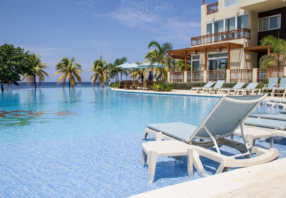 water leisure chair Resort property swimming pool caribbean Beach resort town Villa Lagoon Sea dock marina condominium empty shore sandy