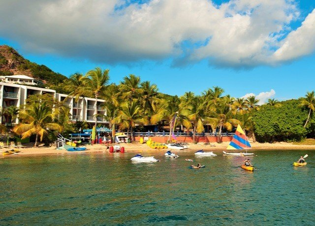 sky water tree leisure Sea boating Lagoon Beach vehicle caribbean shore swimming lined surrounded day Resort