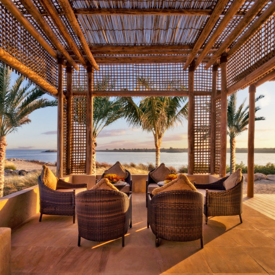 Beach Lounge Luxury Scenic views Secret Getaways Trip Ideas property chair Resort outdoor structure Villa eco hotel cottage