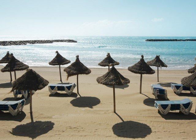 water sky umbrella chair Ocean Beach facing Sea Nature Resort lawn shore day