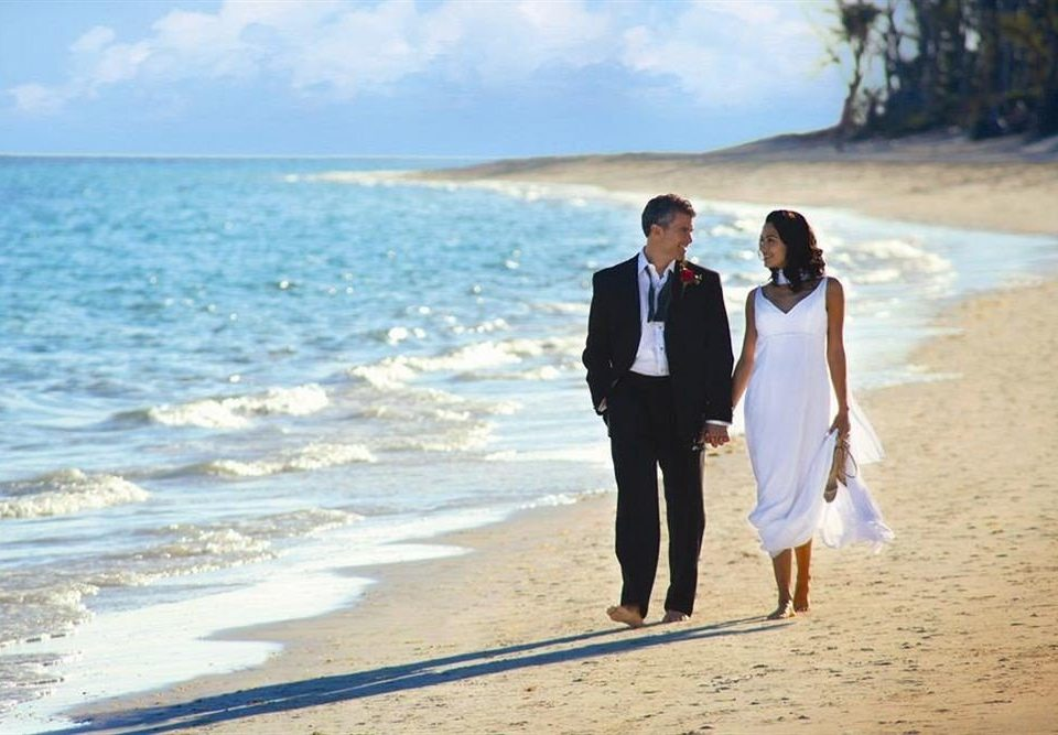 Beach Ocean Romance Romantic water sky ground photograph shore Nature ceremony man wedding event groom sand bride sandy