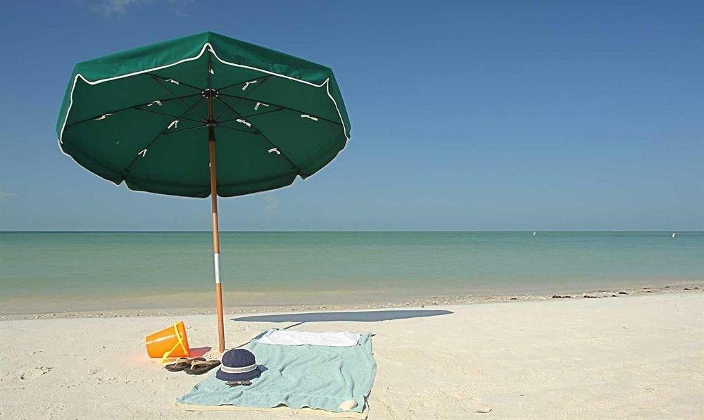 sky water Beach umbrella Nature shore chair Sea Ocean green wind accessory empty sandy day